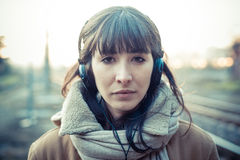 Beautiful young woman listening to music headphones Stock Image