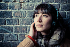 Beautiful young woman listening to music headphones Stock Photography