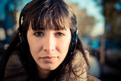 Beautiful young woman listening to music headphones Royalty Free Stock Images