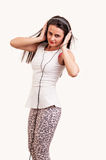Beautiful young woman listening to music on headphones Royalty Free Stock Photo