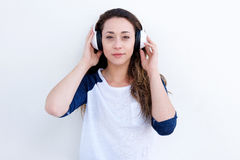 Beautiful young woman listening to music with headphones. Portrait of beautiful young woman listening to music with headphones Royalty Free Stock Photography