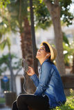 Beautiful young woman listening to music on mobile phone Stock Images