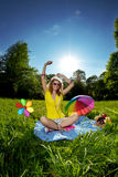 Beautiful young woman listening to music in the park. Stylish young woman listening to music in the park Stock Photos