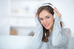 Beautiful young woman listening to music with pleasure Royalty Free Stock Photography