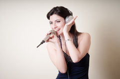Beautiful young woman listening to music Royalty Free Stock Image