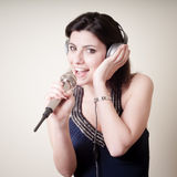 Beautiful young woman listening to music Stock Photo