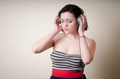 Beautiful young woman listening to music Stock Photography