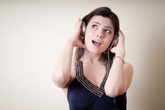 Beautiful young woman listening to music Stock Image