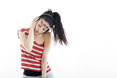 Beautiful young woman listens to music and dances Stock Image