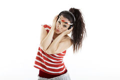 Beautiful young woman listens to music and dances Royalty Free Stock Photography