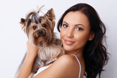 Beautiful young woman with little furry dog Royalty Free Stock Photography