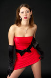 Beautiful young woman in little red Royalty Free Stock Photography