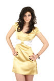 Beautiful young woman in little yellow silk dress Stock Photo