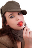 Beautiful young woman with a lollipop Stock Photography