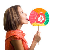 Beautiful young woman with a lollipop Royalty Free Stock Images