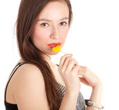 Beautiful young woman with lollipop Royalty Free Stock Photography