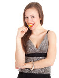 Beautiful young woman with lollipop Stock Image