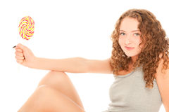 Beautiful young woman with lollipop Royalty Free Stock Photos