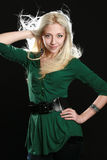 Beautiful young woman with long blond hair. On black background royalty free stock images