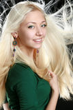 Beautiful young woman with long blond hair. On black background royalty free stock photos