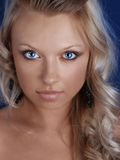 Beautiful young woman with long blond hair Stock Photo