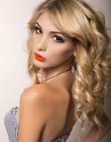 Beautiful young woman with long blond  hair and bright evening makeup Royalty Free Stock Photo