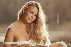 Portrait of beautiful young woman with long blond hair stock photography