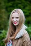 Beautiful young woman with long blond hair Stock Photos