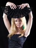 Portrait of the blonde with a fan Stock Images