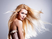 Beautiful young woman with long blonde hair. royalty free stock images