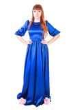 Beautiful young woman in a long blue evening dress. Isolated over white background Stock Images