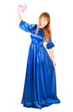 Beautiful young woman in a long blue evening dress with a small Royalty Free Stock Photos
