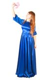 Beautiful young woman in a long blue evening dress with a small Royalty Free Stock Images