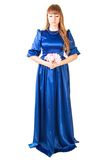 Beautiful young woman in a long blue evening dress with a small Stock Photos
