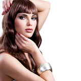 Beautiful young woman with long brown hairs. Royalty Free Stock Photography