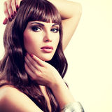 Beautiful young woman with long brown hairs. Royalty Free Stock Image