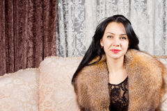 Beautiful woman in a fur collar Royalty Free Stock Photos