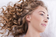 Beautiful young woman with long curly hair Stock Photo