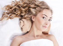 Beautiful young woman with long curly hair Stock Image