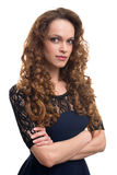 Beautiful young woman with long curly hair Stock Images