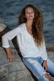 Beautiful young woman with long curly hair Royalty Free Stock Images