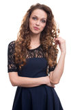 Beautiful young woman with long curly hair Stock Photos
