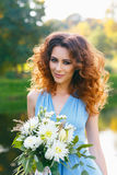 Beautiful young woman with long curly hair Stock Photography