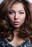 Beautiful young woman with long curly hairs Royalty Free Stock Photos