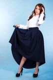 Beautiful young woman in a long dark skirt Royalty Free Stock Images