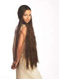 Beautiful young woman with long hair Stock Photography