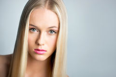 Beautiful young woman with a long hair royalty free stock images