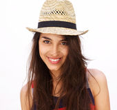 Beautiful young woman with long hair and hat smiling Stock Photography