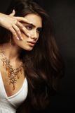 Beautiful young woman with long hair and jewelery. Stock Image