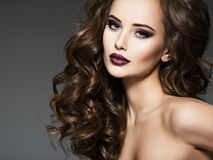 Beautiful young woman with long hair. Portrait of a amazing girl with style fashion makeup Stock Photos